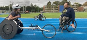 Izzy Vincent in a racing wheelchair and Kurt Fearnley in a wheelchair at the Fearnley Dawes Athletic Centre