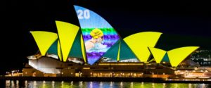 A picture of Izzy Vincent swimming projected on to the Sydney Opera House